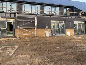 External cladding to side of Village Hall